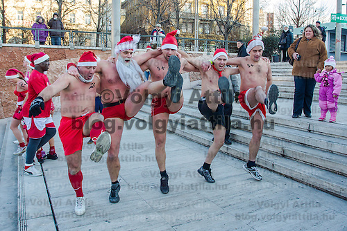 "Participans dance after a half naked ""Santa run"" organised the 5th time to support a charity in Budapest, Hungary on December 09, 2012. ATTILA VOLGYI"