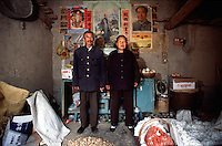 QSFeature02AIDS011 20020212 DONGGUAN, CHINA:  .61 yr old Ding Zhanghong with his wife at their home in Dongguan Village, Henan Province, China 12 February 2002. The Ding  lost their son to AIDS in 2001, and has a nephew that has the deadly disease. Over 700,000 peasant farmers have contracted the HIV virus when they participated in the unregulated blood selling/buying boom of the early and mid nineties. .Photo by: Qilai Shen...