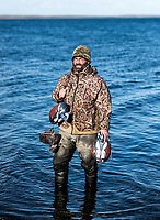 Guide and owner of Four Flyways Outfitters Jeff Wasley pulls in duck decoys in Cold Bay, Alaska, Thursday, November 3, 2016. The Izembek National Wildlife Refuge lies on the northwest coastal side of central Aleutians East Borough along the Bering Sea. <br /> <br /> Photo by Matt Nager