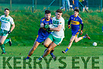 Darragh Sheehy Ballydonoghue and David Foran in action at the North Kerry Championship final played in Moyvane on Sunday.