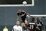 11 August 2004: Earnie Stewart (8) jumps over John Spencer (left) and Dema Kovalenko (21) to head the ball. DC United defeated the Colorado Rapids 3-1 at RFK Stadium in Washington, DC during a regular season Major League Soccer game..