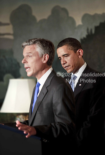 Washington, DC - May 16, 2009 -- Governor Jon Huntsman Jr. of Utah, left, makes remarks after United States President Barack Obama, right, named him as the new United States Ambassador to China.  Huntsman, a Republican served as national co-chair of John McCain's presidential campaign during the 2008 Presidential election.  .Credit: Brendan Smialowski / Pool via CNP