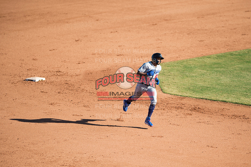 Glendale Desert Dogs first baseman Jared Walker (66), of the Los Angeles Dodgers organization, rounds the bases after hitting a go-ahead three-run home run in the eighth inning of an Arizona Fall League game against the Mesa Solar Sox at Sloan Park on October 27, 2018 in Mesa, Arizona. Glendale defeated Mesa 7-6. (Zachary Lucy/Four Seam Images)