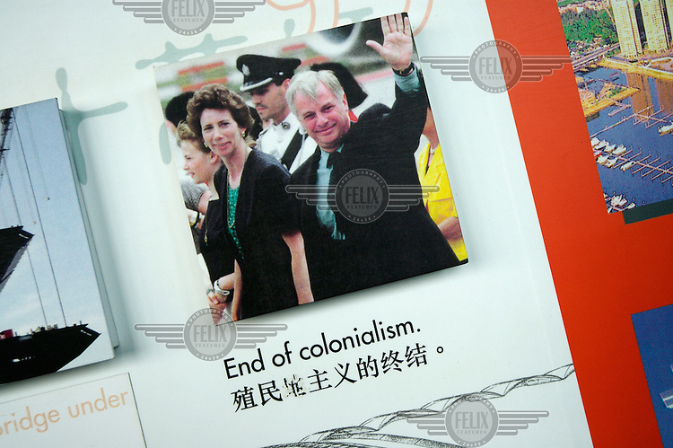 "An exhibition on the history of Hong Kong with an image of the last British Governer Chris Patten waving goodbye, and the caption ""End of Colonialism""."