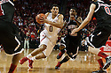 November 30, 2013: Tai Webster (0) of the Nebraska Cornhuskers drives to the hoop with Travon Baker (5) of the Northern Illinois Huskies guarding him closely at the Pinnacle Bank Areana, Lincoln, NE. Nebraska defeated Northern Illinois 63 to 58.