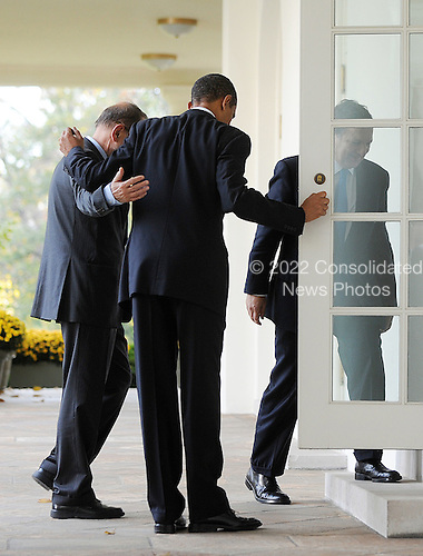 Washington, DC - November 3, 2009 -- United States President Barack Obama, center, holds the door to the Cabinet Room for President of the European Commission JosÈ Manuel Barroso, right, and European Council High Representative Javier Solana, left, as they prepare to participate in the U.S.-European Union Summit at the White House, Tuesday, November 3, 2009 in Washington, DC..Credit: Olivier Douliery / Pool via CNP