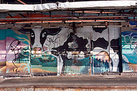 (040826-SWR0050) New York - A Cow mural adorns the walls of a meat processing plant in Gansevoort Market, Meat Packing District.