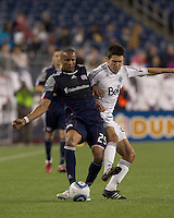New England Revolution midfielder Darrius Barnes (25) passes the ball as Vancouver Whitecaps FC midfielder Shea Salinas (22) pressures. In a Major League Soccer (MLS) match, the New England Revolution defeated the Vancouver Whitecaps FC, 1-0, at Gillette Stadium on May14, 2011.