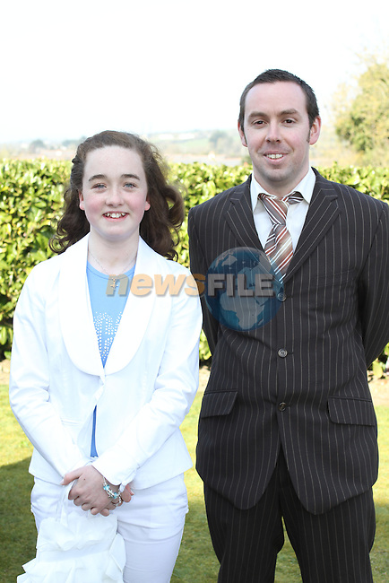 Emily Gough with her sponsor Paul O'Connor at Tullyallen NS. Confirmation...(Photo credit should read Jenny Matthews www.newsfile.ie)....This Picture has been sent you under the conditions enclosed by:.Newsfile Ltd..The Studio,.Millmount Abbey,.Drogheda,.Co Meath..Ireland..Tel: +353(0)41-9871240.Fax: +353(0)41-9871260.GSM: +353(0)86-2500958.email: pictures@newsfile.ie.www.newsfile.ie.