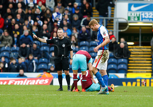 21.02.2016. Ewood Park, Blackburn, England. Emirates FA Cup 5th Round. Blackburn Rovers versus West Ham United. Referee Jonathan Moss points towards the dressing room as he sends off Blackburn Rovers midfielder Chris Taylor.