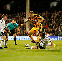 Kamil Grosicki of Hull City is foiled by Kevin McDonald of Fulham during the Sky Bet Championship match between Fulham and Hull City at Craven Cottage, London, England on 13 September 2017. Photo by Carlton Myrie.