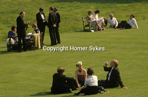 Glyndebourne Festival Opera. Glyndebourne champaigne. Festival goers enjoy a glass of champaign on the lawns during the long interval  Circa 1985