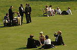 Glyndebourne Festival Opera. Festival goers enjoy a glass of champaign on the lawns during the long interval.Lewes East Sussex UK 1980s