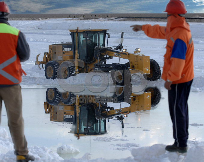 """Operation called """"harvest"""" in some of SQM ponds at Salar de Atacama in North of Chile. After the sun completed a chemical process in the ponds of salt and water, the minerals are picked up to process at SQM plants."""