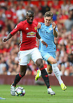 Paul Pogba of Manchester United tussles with John Stones of Manchester City during the Premier League match at Old Trafford Stadium, Manchester. Picture date: September 10th, 2016. Pic Simon Bellis/Sportimage