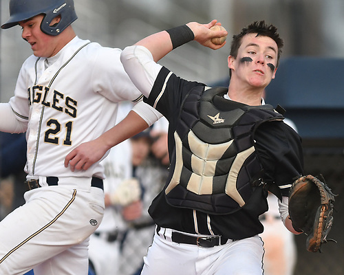 Trevor Fagan #20, Wantagh catcher, right, throws to first base to complete an inning-ending, 1-2-3 double play in the bottom of the fourth inning of a Nassau County varsity baseball game against host Bethpage High School on Monday, April 3, 2017. Wantagh won by a score of 12-3.