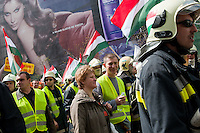 Protesting firemen, police and armed force officers attend an anti-government rally in Budapest, Hungary on April 16, 2011..Thousands of Hungarians, including policemen and firefighters, on Saturday protested against the government's austerity measures. The government has launched a package of fiscal reforms to cut the budget deficit, including scrapping early retirement, which mostly affects law enforcement personnel.