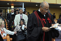 Friends and family enter the funeral of housing activist Beauty Turner, 51, including Turner's elderly mother (center in wheelchair), a one-time resident of the Robert Taylor Homes who led the Beauty Turner Ghetto Bus Tour and received national recognition in publications such as The Wall Street Journal, proceeded by Reverend Roosevelt James at the Greater Harvest Missionary Baptist Church on South State Street in Chicago, Illinois on December 26, 2008.  Turner died of an aneurysm on December 18.