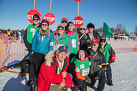 Volunteer chute crew team gather for a photo at the Restart of the 2016 Iditarod in Willow, Alaska.  March 06, 2016.