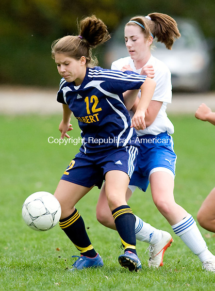 WOODBURY, CT - 12 OCTOBER 2009 -101209JT15-<br /> Gilbert's Rachel Wendel handles the ball while under pressure from Nonnewaug's Gretchen Wortman during Monday's game at Nonnewaug. The teams tied, 3-3.<br /> Josalee Thrift Republican-American