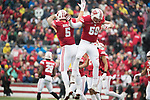 Wisconsin Badgers linebackers Garret Dooley (5) and Tyler Johnson (59) celebrate during an NCAA College Big Ten Conference football game against the Michigan Wolverines Saturday, November 18, 2017, in Madison, Wis. The Badgers won 24-10. (Photo by David Stluka)