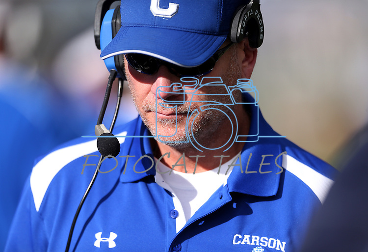 Carson's Head Coach Blair Roman works the sidelines during the NIAA D-1 Northern Regional title game against Reed at Bishop Manogue High School in Reno, Nev., on Saturday, Nov. 29, 2014. Reed won 28-25.<br /> Photo by Cathleen Allison