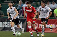 l-r: Becky Sauerbrunn (22) of the magicJack, Christine Sinclair (12) of the Western New York Flash and Abby Wambach of the magicJack. The Western New York Flash defeated the magicJack 3-0 in Women's Professional Soccer (WPS) at Sahlen's Stadium in Rochester, NY May 22, 2011.