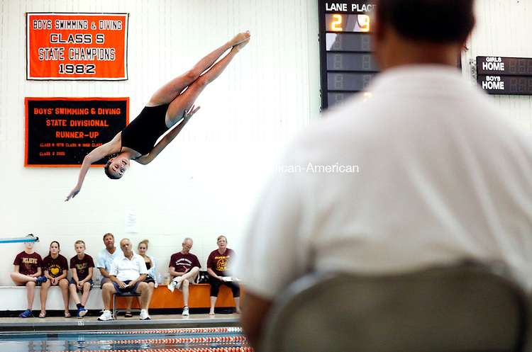 Watertown, CT- 29 September 2015-092915CM07- Watertown's Kelsey DeJesus performs a dive during a meet against Sacred Heart on Tuesday.      Christopher Massa Republican-American