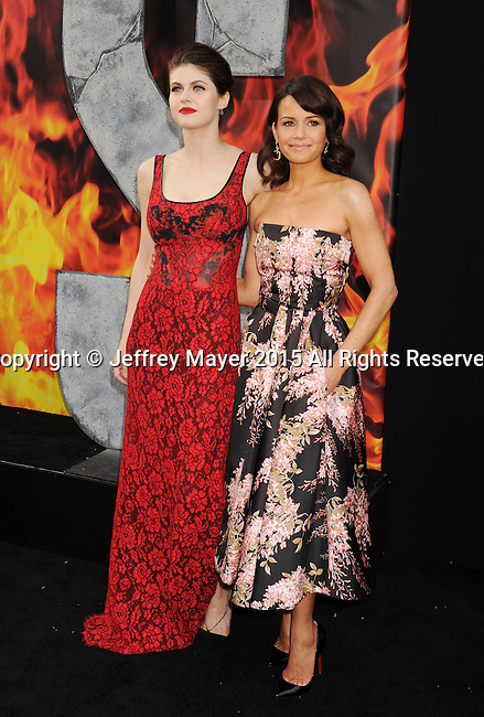 HOLLYWOOD, CA - MAY 26: Actresses Alexandra Daddario (L) and Carla Gugino arrive at the 'San Andreas' - Los Angeles Premiere at TCL Chinese Theatre IMAX on May 26, 2015 in Hollywood, California.