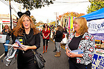 OCTOBER 22, 2011 - MERRICK, NEW YORK: Democratic candidate meets people and hands out campaign literature at Merrick Street Fair. Merokean Claudia Borecky (right) challenged Republican incumbent for Town of Hempstead Town Council.