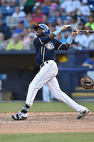 Asheville Tourists center fielder Wes Rogers (24) swings at a pitch during a game against the Charleston RiverDogs on June 13, 2015 in Asheville, North Carolina. The Tourists defeated the RiverDogs 10-6. (Tony Farlow/Four Seam Images)