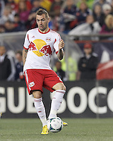 New York Red Bulls midfielder Jonny Steele (22) passes the ball. In a Major League Soccer (MLS) match, the New England Revolution (blue) tied New York Red Bulls (white), 1-1, at Gillette Stadium on May 11, 2013.