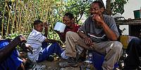 Drinking Umqombothi, the traditional maize beer. Pienarsig, Nieu Bethesda, Graet Karoo, SA 2010