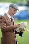 XXjob: Denis O'Sullivan from Rathmore pictured studying the form is at Killarney Races on Tuesday night.<br /> Picture by Don MacMonagle