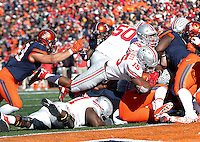 Ohio State Buckeyes running back Ezekiel Elliott (15) dives for a touchdown in the third quarter of the college football game between the Ohio State Buckeyes and the Illinois Fighting Illini at Memorial Stadium in Champaign, Ill., Saturday morning, November 14, 2015. The Ohio State Buckeyes defeated the Illinois Fighting Illini 28 - 3. (The Columbus Dispatch / Eamon Queeney)