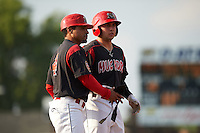 Batavia Muckdogs designated hitter Alex Fernandez (46) with manager Angel Espada (4) during a game against the West Virginia Black Bears on August 30, 2015 at Dwyer Stadium in Batavia, New York.  Batavia defeated West Virginia 8-5.  (Mike Janes/Four Seam Images)