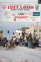 Lachlan Clarke and team leave the ceremonial start line with an Iditarider at 4th Avenue and D street in downtown Anchorage, Alaska during the 2015 Iditarod race. Photo by Jim Kohl/IditarodPhotos.com