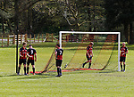 Keswick 1 Kendal 1, 15/04/2017. Fitz Park, Westmoreland League. Keswick players taking the goalposts down at full time. Photo by Paul Thompson.