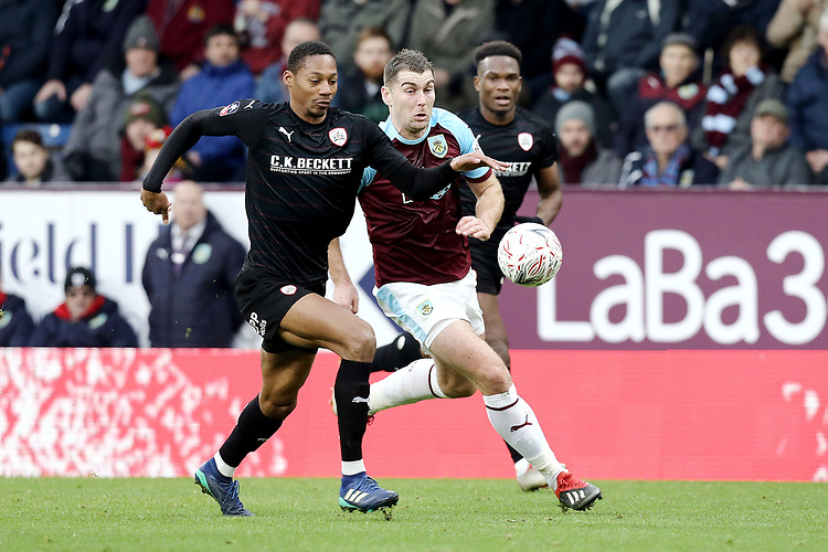 Burnley's Sam Vokes battles with Barnsley's Ethan Pinnock<br /> <br /> Photographer Rich Linley/CameraSport<br /> <br /> Emirates FA Cup Third Round - Burnley v Barnsley - Saturday 5th January 2019 - Turf Moor - Burnley<br />  <br /> World Copyright © 2019 CameraSport. All rights reserved. 43 Linden Ave. Countesthorpe. Leicester. England. LE8 5PG - Tel: +44 (0) 116 277 4147 - admin@camerasport.com - www.camerasport.com