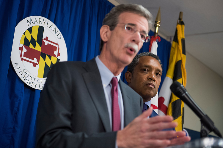 UNITED STATES - JUNE 12: D.C. Attorney General Karl Racine, right, and Maryland Attorney General Brian Frosh conduct a news conference on a lawsuit they've filed against President Donald Trump alleging he violated emoluments clauses in the Constitution by accepting foreign payments through his businesses on June 12, 2017. (Photo By Tom Williams/CQ Roll Call)