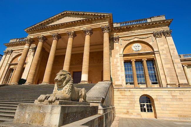 Lion statue in front of the neo-classic south front with Corinthian columns of the Duke of Buckingham's  Stowe House designed by Robert Adam in 1771,  Buckingham, England
