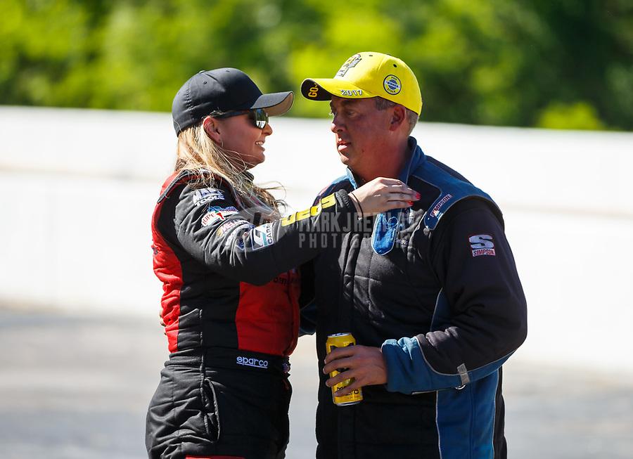May 7, 2017; Commerce, GA, USA; NHRA pro stock driver Erica Enders-Stevens (left) congratulates race winner Bo Butner during the Southern Nationals at Atlanta Dragway. Mandatory Credit: Mark J. Rebilas-USA TODAY Sports