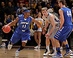 SIOUX FALLS, SD - MARCH 11:  Isaiah McCray #11 of IPFW dribbles away from Nate Wolters #3 of South Dakota State during their semi-final game at the 2013 Summit League Basketball Championships Monday at the Sioux Falls Arena.  (Photo by Dick Carlson/Inertia)