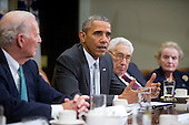 United States President Barack Obama, second left, speaks while meeting with current and former diplomatic and national security officials including James Baker, former U.S. Secretary of State, from left, Obama, Henry Kissinger, former U.S. Secretary of State, Madeleine Albright, former U.S. Secretary of State and founder of Albright Stonebridge Group LLC, and Admiral Mike Mullen, former chairman of the U.S. Joint Chiefs of Staff, to discuss the Trans-Pacific Partnership (TPP) in the Roosevelt Room of the White House in Washington, D.C., U.S., on Friday, November 13, 2015. Obama, hoping to kick off a new phase of selling the TPP at home while enhancing its prospects overseas, has enlisted some of the nation's top national security leaders to give testimonials. <br /> Credit: Andrew Harrer / Pool via CNP