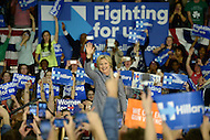 "Charlotte, NC - March 14, 2016: Former U.S. Secretary of State and 2016 Democrat presidential candidate Hillary Clinton waves to supporters after a campaign speech at the Grady Cole Center in Charlotte, North Carolina, March 14, 2016, one day before 'Super Tuesday"" voting.  (Photo by Don Baxter/Media Images International)"