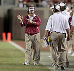 Florida State head coach Bobby Bowden (L) talks with offensive coordinator Jimbo Fisher in the second half of University of Miami's 38-34 defeat of the Florida State Seminoles in Tallahassee September 7, 2009. (Mark Wallheiser/TallahasseeStock.com)