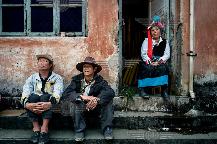 Men & women from nearby villages, dressed in traditional Nu and Tibetan costumes, wait to go on stage at the annual Fairy Festival where local Nu, Tibetan and Lisu minorities dance and perform.