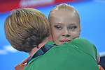 Wales' Elizabeth Beddoe hugs a coach at the end of her performance in the women's gymnastics artistic balance beam final<br /> <br /> Photographer Chris Vaughan/Sportingwales<br /> <br /> 20th Commonwealth Games - Day 9 - Friday 1st August 2014 - Gymnastics - SECC - Glasgow - UK
