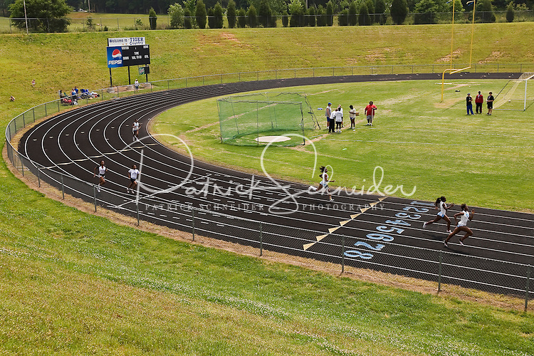Overall view of runners competing in a running event during a track and field competition.