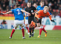 United's Gary Mackay Steven is caught late by Gers Sebastian Faure.